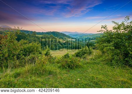 Carpathian Mountain Countryside At Sunrise. Beautiful Rural Landscape In Summertime With Forested Hi
