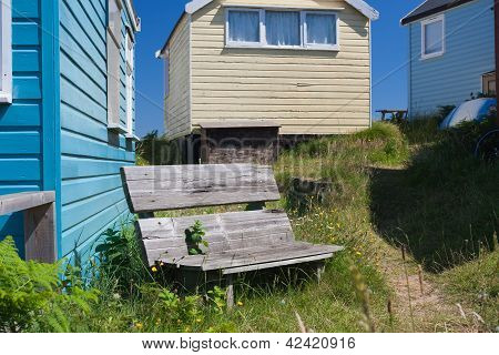 Mudeford Beach Huts And Bench
