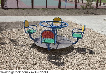 Swing Carousel On An Empty Playground For Children In The Courtyard Of A New Apartment Building, No