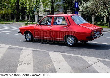 Bucharest, Romania, 24 April 2021 Old Retro Vivid Red Romanian Dacia 1310 Classic Car In Traffic In