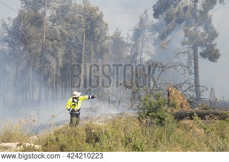 Mevasseret Zion, Israel - June 19th, 2021: A Fire Fighter During A Pine Forest Fire On The Municipal