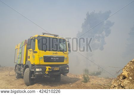 Mevasseret Zion, Israel - June 19th, 2021: A Fire Engine Near The Site Of A Pine Forest Fire On The