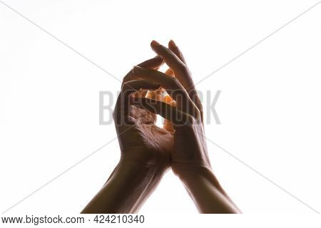 Hands Make Magic, Or Pray That The Light Falls From Above On Hand. Radiance Between The Palms.