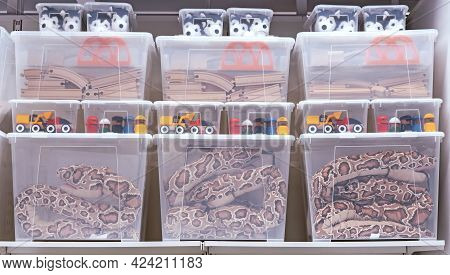 Transparent Plastic Containers With Various Children's Toys.