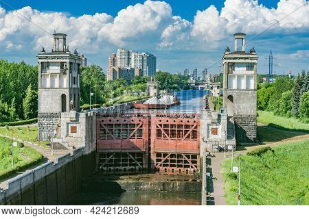 Freight Ship Moves Through The Gateway Of The River. Moscow. Russia.