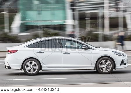 Moscow , Russia - April 2021: Hyundai Sonata Lf Seventh Generation In The City Street. Side View Of
