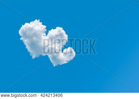 Couple Of Heart Shaped Clouds On A Clear Blue Sky Background. Concept Of Love And Romance. Pair Of C