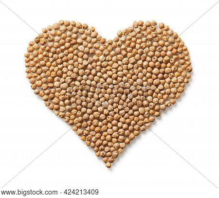 Raw Dry Chickpeas In A Heart Shape Isolated On White Background. Vegetarian Food And Hummus Ingredie