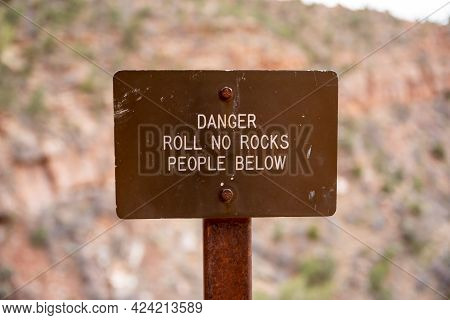Danger Roll No Rocks Sign  Cautions Hikers On The Rim Not To Endanger Hikers Below