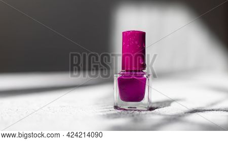 Nail Polish On A White Background With Shadows . The Concept Of Nail Polish Without Inscriptions. Li