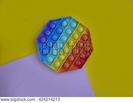 Antistress Toy On A Colored Background Relax