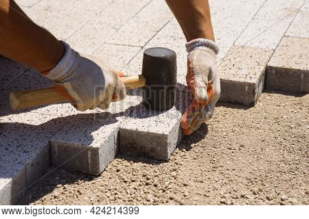 Paver Is Laying Paving Stones. Laying Concrete Paving Stones.