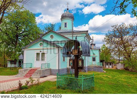 Churchyard With Crucifixion . In The Yard Of Orthodox Church