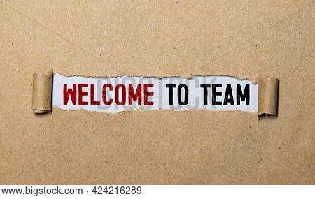 Businesspeople Holding Whiteboard With 'welcome To The Team' Text. Teamwork Concept.
