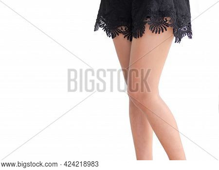Legs Woman With Black Pants On White Background. Authentic Skin Tan And Sliming Fit. Lose Weight Die