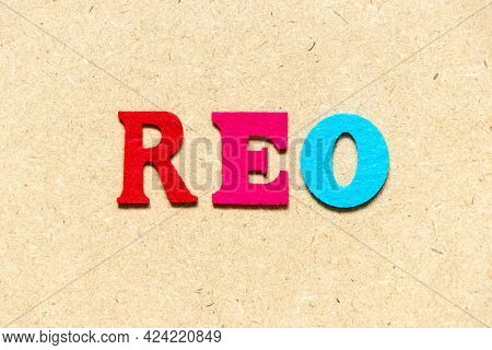 Color Cloth Alphabet Letter In Word Reo (abbreviation Of Real Estate Owned) On Wood Background