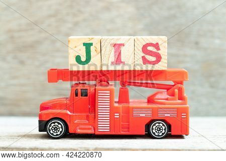 Fire Ladder Truck Hold Letter Block In Word Jis (abbreviation Of Just In Sequence) On Wood Backgroun