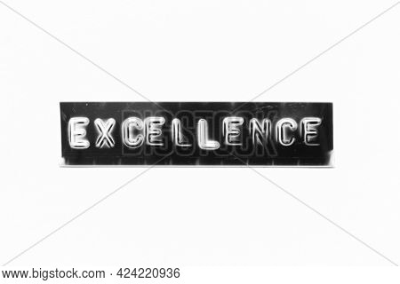 Embossed Letter With Word Excellence In Black Banner On White Paper Background