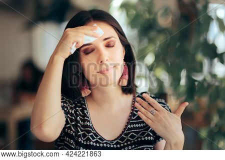 Woman Feeling Hot During Summer Wiping Her Forehead