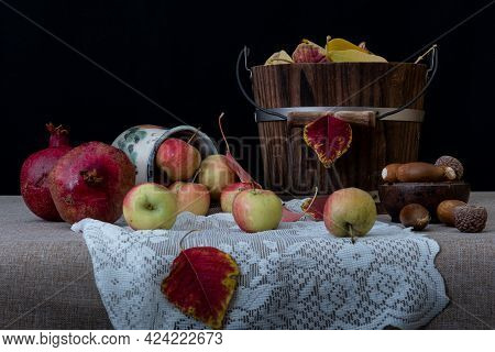 Autumn Harvest Fruit Still Life, California, A Wooden Bucket On Fabric Covered Table Decorated With