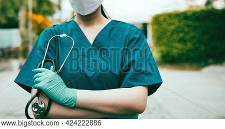 Hospital Worker Standing Outside Hospital With A Stethoscope