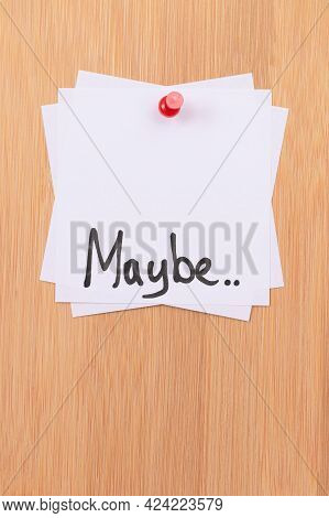 Maybe.. - White Sticky Notes With Written Word Maybe, Pinned To The Wooden Message Board. To Do List