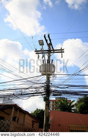 Salvador, Bahia, Brazil - June 18, 2021: Transformer Is Seen Along Exposed Wires In Electric Network