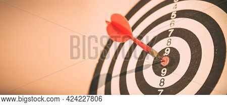 Bulls Eye Or Bullseye Target Or Dart Board Has Red Dart Arrow Throw Hitting The Center Of A Shooting