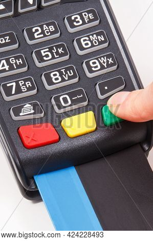 Hand Of Woman Entering Pin Code On Payment Terminal. Cashless Paying For Shopping. Credit Card Reade