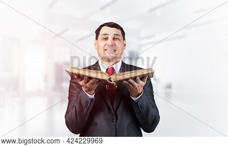 Happy Senior Businessman Holding Open Book. Portrait Of Smiling Adult Man In Business Suit And Tie S