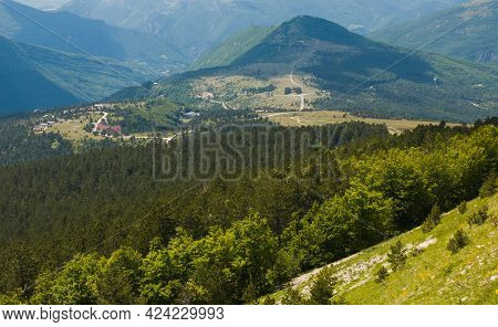 Panoramic View Of Frontignano Village Surrounded By Green Forest In The National Park Of Monti Sibil
