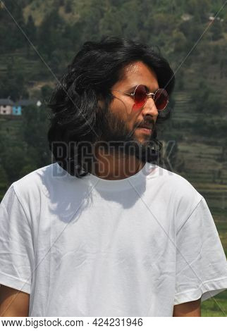 Portrait Shot Of A Handsome Long Haired Indian Young Men Wearing Sunglasses With Looking Sideways, A