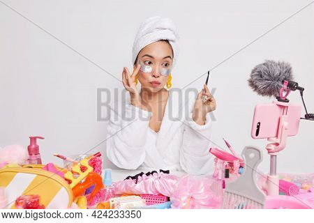 Lovely Asian Female Mdel Holds Professional Brush Puts Undereye Patches Uses Tools For Makeup Record