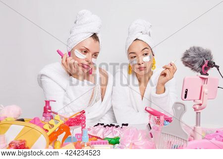 Unimpressed Bored Female Models Hold Lipstick Apply Beauty Patches Under Eyes Shoot Cosmetic Product