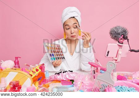 Professional Female Makeup Artist Applies Shadow On Eyes Holds Colorful Palette Uses Cosmetic Tools