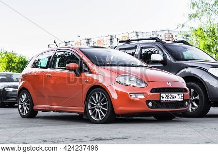 Moscow, Russia - June 2021: Orange Fiat Grande Punto Three Door Hatchback Parked On The Street In Th