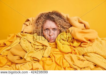 Displeased Female Volunteer Collects Clothes For Donation Charity Organization Overwhelmed With Big