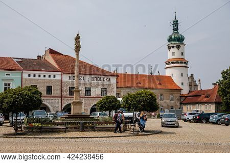 Column With Statue Of Virgin Mary, Main Husovo Square On Sunny Day, Renaissance And Baroque Historic