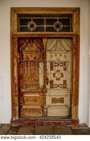 Weathered Cracked White Peeling Paint So Old Wooden Double Carved Entrance Door In Wall Of Ancient S