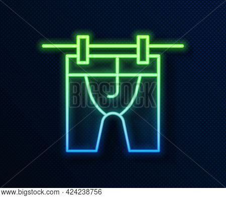 Glowing Neon Line Drying Clothes Icon Isolated On Blue Background. Clean Shirt. Wash Clothes On A Ro
