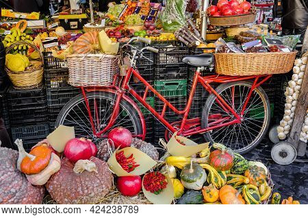 A Classic Arrangement Of Fruit And Vegetable At A Market Stall Using A Bicycle With A Basket Carryin
