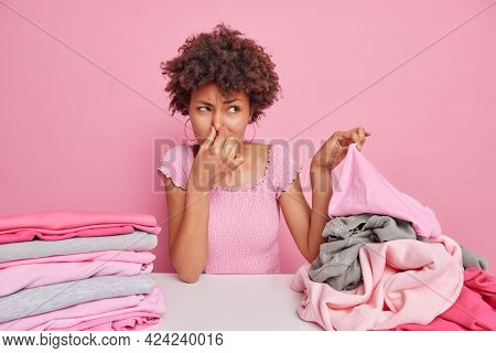 Afro American Housewife Covers Nose As Smells Dirty Laundry Squints Face From Unpleasant Stench Does