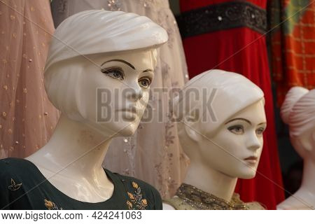 Mannequins Dressed In Latest Indian Clothes In Front Of A Retail Cloth Shop. Mannequin Dressed In Tr