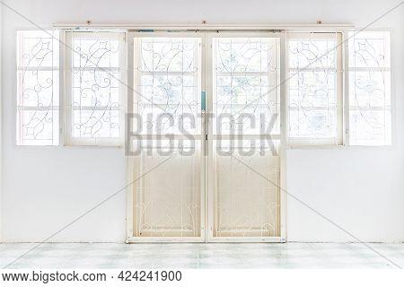 White Wrought Iron Door In White Wall