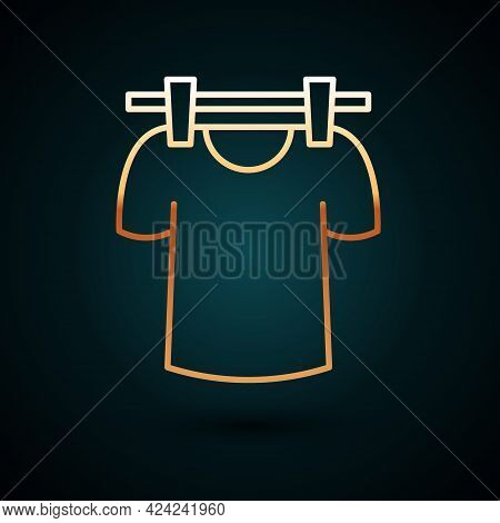 Gold Line Drying Clothes Icon Isolated On Dark Blue Background. Clean Shirt. Wash Clothes On A Rope