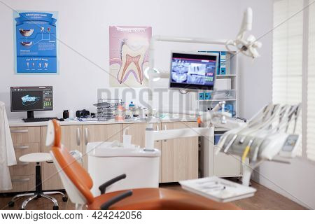 Modern Orange Dentist Cabinet With Sterile Utensils. Stomatology Cabinet With Nobody In It And Orang