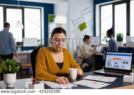 Manager Of Financial Company Reading Analysing Statistics And Team Working On Deadline. Executive En