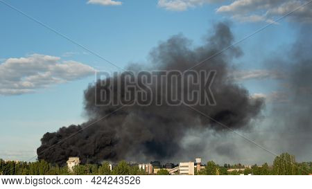 Burning Building With Black Smoke. Factory Fire Burning. Huge Smoke Clouds After Explosion. Technoge