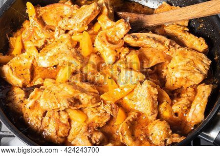 Indian Style Chicken Cooking. Cooking Traditional Chicken Curry. Chicken Pieces Are Cooked In A Pan