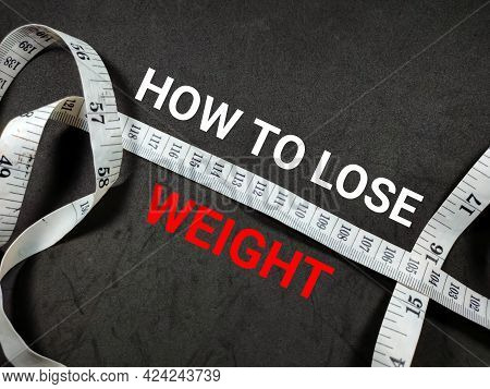 Healthcare Concept. Text How To Lose Weight With Measuring Tape On Black Background.